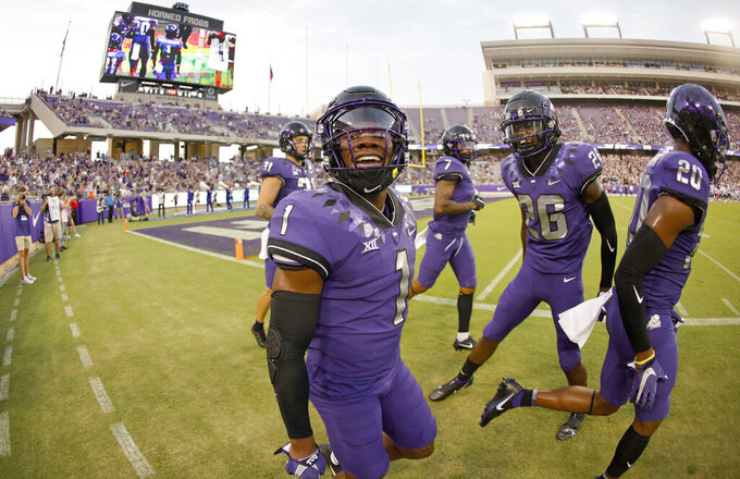 TCU cornerback Tre'Vius Hodges-Tomlinson (1) reacts after intercepting a pass as safety Bud Clark (26) looks on against Duquesne during the first half of an NCAA college football game Saturday, Sept. 4, 2021, in Fort Worth, Texas. (AP Photo/Ron Jenkins)