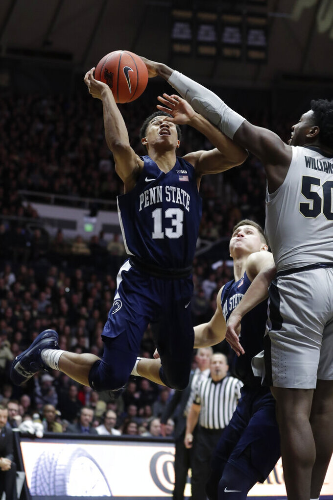 Purdue forward Trevion Williams (50) blocks the shot of Penn State guard Rasir Bolton (13) during the first half of an NCAA college basketball game in West Lafayette, Ind., Saturday, Feb. 16, 2019. (AP Photo/Michael Conroy)
