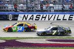 Kyle Busch (54) leads Justin Allgaier (7) during a NASCAR Xfinity Series auto race at Nashville Superspeedway, Saturday, June 19, 2021, in Lebanon, Tenn. (AP Photo/Mark Humphrey)