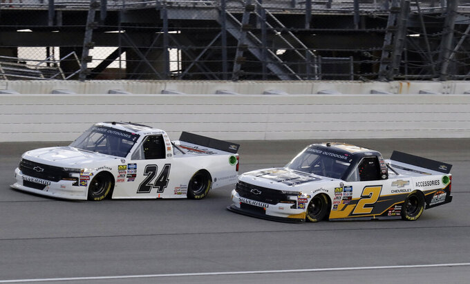 Brett Moffitt, left, drives past Sheldon Creed during the NASCAR Truck Series auto race at Chicagoland Speedway in Joliet, Ill., Friday, June 28, 2019. (AP Photo/Nam Y. Huh)