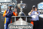 Scott Dixon, left, and Chip Ganassi celebrate after winning the NTT IndyCar Series Championship following an IndyCar auto race Sunday, Oct. 25, 2020, in St. Petersburg, Fla. (AP Photo/Mike Carlson)