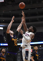 Connecticut's Josh Carlton (25) shoots over East Carolina's Dimitrije Spasojevic (32) during the second half of an NCAA college basketball game, Sunday, Feb. 3, 2019, in Hartford, Conn. (AP Photo/Jessica Hill)