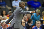 FILE - In this March 11, 2020, file photo, Oklahoma State head coach Mike Boynton directs his team during the first half of an NCAA college basketball game against Iowa State in the first round of the Big 12 men's basketball tournament in Kansas City, Kan. The Cowboys open the season at Texas-Arlington on Nov. 25 and will visit Marquette on Dec. 1. (AP Photo/Orlin Wagner, File)
