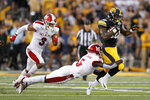 Iowa running back Mekhi Sargent, right, tries to break a tackle by Miami of Ohio defensive back Emmanuel Rugamba (5) during the first half of an NCAA college football game, Saturday, Aug. 31, 2019, in Iowa City, Iowa. (AP Photo/Charlie Neibergall)