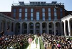 Models wear creations as part of the MSGM Spring-Summer 2020 collection, unveiled during the fashion week, in Milan, Italy, Saturday, Sept. 21, 2019. (AP Photo/Antonio Calanni)