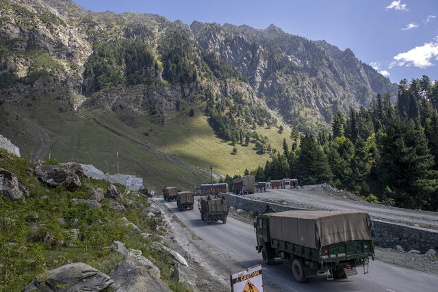 FILE - In this Sept. 9, 2020, file photo, an Indian army convoy moves on the Srinagar- Ladakh highway at Gagangeer, northeast of Srinagar, Indian-controlled Kashmir. China on Tuesday called India's designation of the region along their disputed border as a union territory an illegal move, and voiced new objections to infrastructure construction that seems to strengthen India's position in the area. (AP Photo/ Dar Yasin, File)