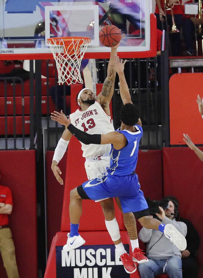 St. John's Marvin Clark II (13) blocks a shot by Creighton's Davion Mintz (1) during the second half of an NCAA college basketball game Wednesday, Jan. 16, 2019, in New York. St. John's won 81-66. (AP Photo/Frank Franklin II)