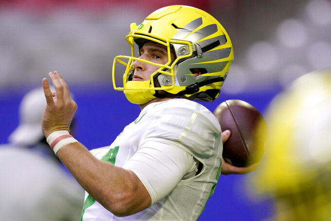 Oregon quarterback Tyler Shough (12) warms up prior to the Fiesta Bowl NCAA college football game against Iowa State, Saturday, Jan. 2, 2021, in Glendale, Ariz. (AP Photo/Ross D. Franklin)