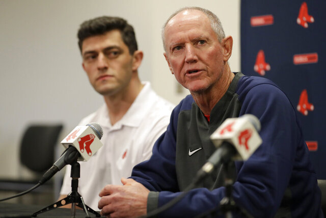 Ron Roenicke, right, speaks as Red Sox Chief Baseball Officer Chaim Bloom looks on after being after being named interim manager of the Boston Red Sox baseball team Tuesday, Feb. 11, 2020, in Fort Myers, Fla. (AP Photo/John Bazemore)