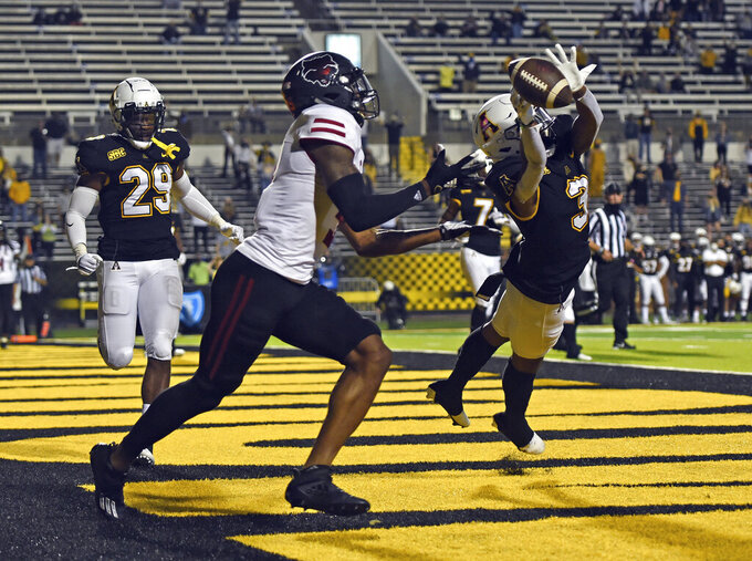 Appalachian State defensive backShaun Jolly, right, breaks up a pass in the end zone intended for Arkansas State wide receiver Jonathan Adams Jr., front left, in the first half of an NCAA college football game, Thursday, Oct. 22, 2020, at Kidd Brewer Stadium in Boone, N.C. (Walt Unks/Winston-Salem Journal via AP)