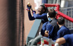 Atlanta Braves' Ronald Acuña Jr., laughs in the dugout during team practice at Truist Park on Sunday, July 5, 2020, in Atlanta. (AP Photo/Brynn Anderson)