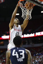 Houston Rockets' Johnathan Williams dunks against the Utah Jazz during the first half of an NBA summer league basketball game Thursday, July 11, 2019, in Las Vegas. (AP Photo/John Locher)