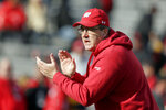 FILE - In this Nov. 16, 2019, file photo, Wisconsin head coach Paul Chryst claps before an NCAA college football game against Nebraska in Lincoln, Neb. Wisconsin faces Penn State on Saturday as they open their college football season. (AP Photo/Nati Harnik, File)