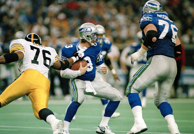 "File-Seattle Seahawks quarterback, Rick Mirer (3) is sacked for a seven-yard-loss by Kevin Henry (76) of the Pittsburgh Steelers during the second quarter of their NFL game in Seattle, Wash., Sunday, Dec. 26, 1993. Dementia tests in the NFL concussion litigation allow doctors to use different baseline standards for Black and white retired players, making it more difficult for Blacks to show injury and qualify for awards, lawyers for two ex-players argued in court filings Tuesday, Aug. 25, 2020. Lawyers for ex-players Henry and Najeh Davenport said their clients were denied awards ""based on a discriminatory testing regime"" that weighs sociological factors including race. Both men would have qualified for awards had race not been considered, they said. (AP Photos/Gary Stewart, File)"