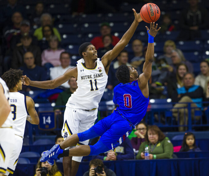 Notre Dame's Juwan Durham (11) blocks Presbyterian's Chris Martin (0) from shooting during an NCAA college basketball game Monday, Nov. 18, 2019,  in South Bend, Ind. (Michael Caterina/South Bend Tribune via AP)