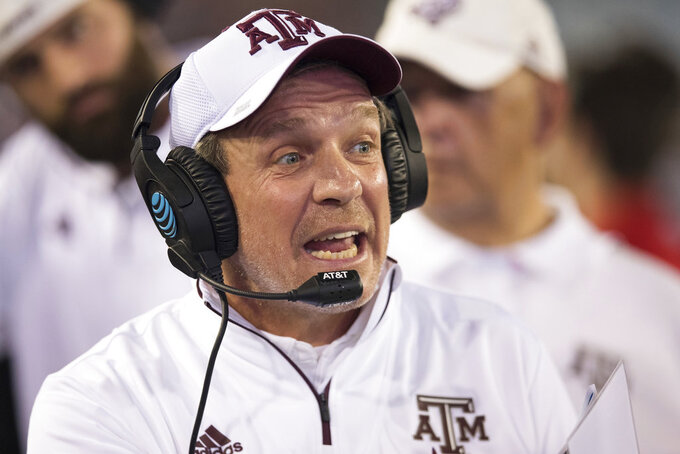 Texas A&M coach Jimbo Fisher watches from the sideline during the first half of the Gator Bowl NCAA college football game against North Carolina State on Monday, Dec. 31, 2018, in Jacksonville, Fla. (James Gilbert/The Florida Times-Union via AP)