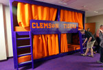 In this Jan. 31, 2017 photo, members of the media look over a nap room inside the Clemson Football Facility at Clemson University in Clemson, S.C. When it comes to facilities in the ACC, Clemson has set the standard.  The Tigers opened a $55 million team headquarters two years ago that includes a miniature golf course, a slide and a nap room. With the team pursuing its fourth straight ACC title and College Football Playoff berth, they feel the investment is paying off. (Ken Ruinard/The Independent-Mail via AP)