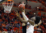 Oklahoma State guard Isaac Likekele, right, shoots in front of Kansas State forward Xavier Sneed, rear, in the first half of an NCAA college basketball game in Stillwater, Okla., Saturday, Feb. 2, 2019. (AP Photo/Sue Ogrocki)