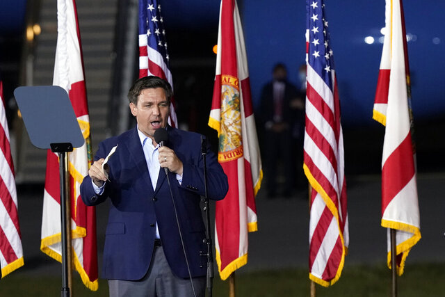 Florida Gov. Ron DeSantis speaks before President Donald Trump at a campaign rally in Pensacola, Fla., Friday, Oct. 23, 2020. (AP Photo/Gerald Herbert)