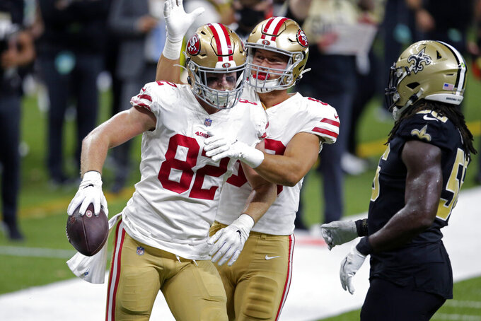 San Francisco 49ers tight end Ross Dwelley (82) reacts after a pass reception in the first half of an NFL football game in New Orleans, Sunday, Nov. 15, 2020. (AP Photo/Butch Dill)