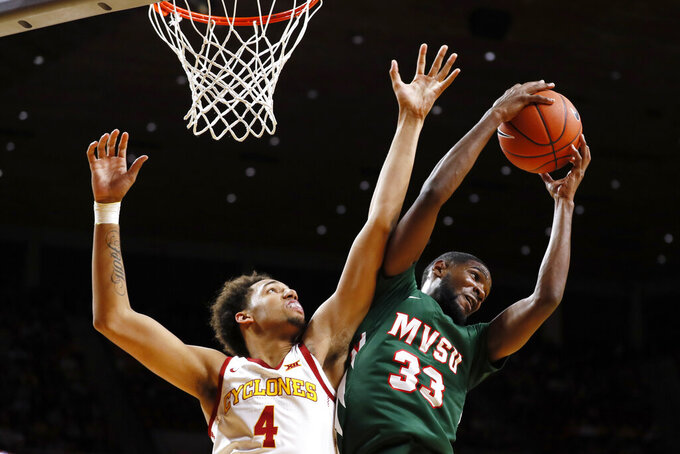 Mississippi Valley State's Brandon Kimble (33) grabs a rebound over Iowa State forward George Conditt IV (4) during the first half of an NCAA college basketball game, Tuesday, Nov. 5, 2019, in Ames, Iowa. (AP Photo/Charlie Neibergall)