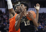 Wake Forest's Jaylen Hoard (10) loses the ball as he drives against Miami's Ebuka Izundu during the first half of an NCAA college basketball game in Winston-Salem, N.C., Tuesday, Feb. 26, 2019. (AP Photo/Chuck Burton)