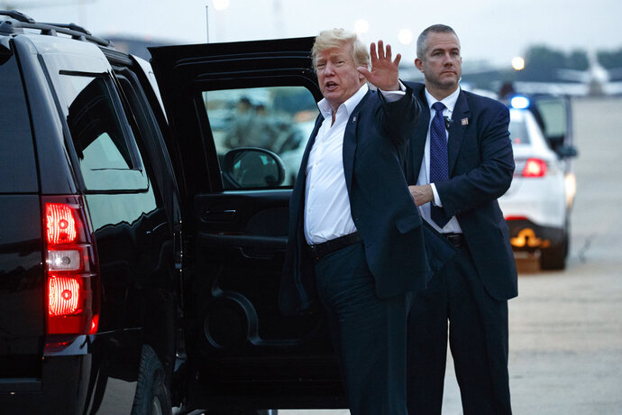 U.S. President Donald Trump yells to reporters after arriving at Andrews Air Force Base after a summit with North Korean leader Kim Jong Un in Singapore, Wednesday, June 13, 2018, in Andrews Air Force Base, Me. (AP Photo/Evan Vucci)
