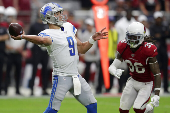 Detroit Lions quarterback Matthew Stafford (9) shows as Arizona Cardinals free safety D.J. Swearinger (36) pursues during the second half of an NFL football game, Sunday, Sept. 8, 2019, in Glendale, Ariz. (AP Photo/Darryl Webb)