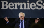 """In this March 10, 2019 photo, 2020 Democratic presidential candidate Sen. Bernie Sanders addresses a rally during a campaign stop, in Concord, N.H. The Democratic Socialists of America has endorsed Vermont Sen. Bernie Sanders in his second run for president. The New York-based group says its National Political Committee voted to endorse Sanders at a meeting on Thursday and it's moving forward with """"an independent campaign"""" to elect him and """"advance a class-struggle agenda."""" The 77-year-old Sanders announced his Democratic presidential bid last month, promising a government about """"economic, social, racial and environmental justice."""" (AP Photo/Steven Senne)"""