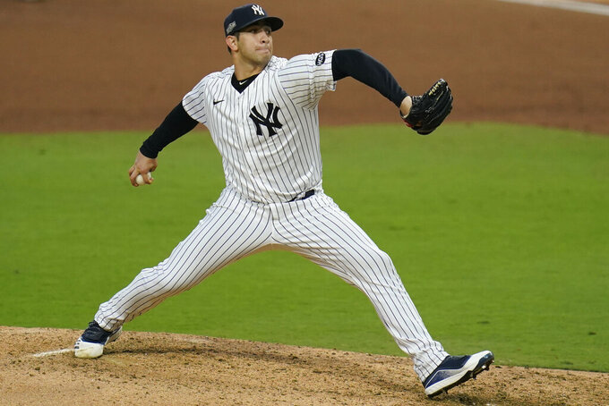 New York Yankees relief pitcher Luis Cessa throws against the Tampa Bay Rays during the sixth inning in Game 3 of a baseball American League Division Series, Wednesday, Oct. 7, 2020, in San Diego. (AP Photo/Gregory Bull)