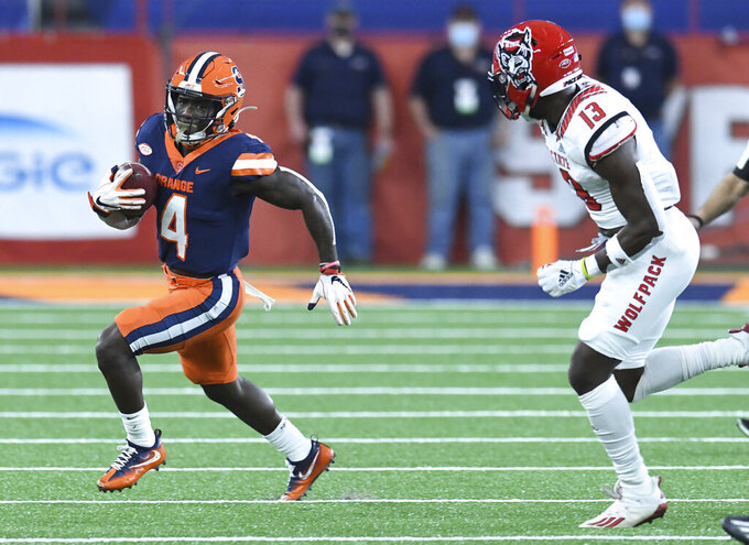 Syracuse wide receiver Nykeim Johnson (4) runs past a defender during the first half of an NCAA college football game against North Carolina State on Saturday, Nov. 28, 2020, at the in Syracuse, N.Y. (Scott Schild /The Post-Standard via AP)