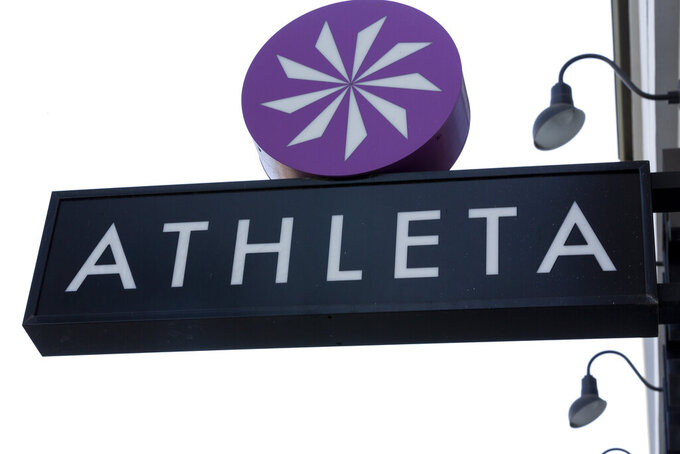 File-This Sept. 20, 2018, file photo shows the Athleta clothing logo is seen at a store in Pasadena, Calif. Simone Biles' sponsors including Athleta and Visa are lauding her decision to put her mental health first and withdraw from the gymnastics team competition during the Olympics. It's the latest example of sponsors praising athletes who are increasingly open about mental health issues. (AP Photo/Damian Dovarganes, File)