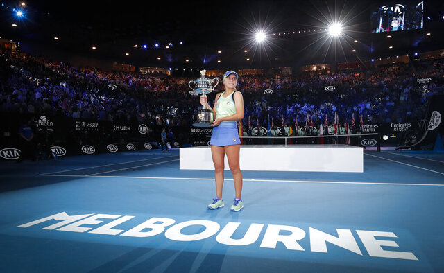 FILE - In this Feb. 1, 2020, file photo, Sofia Kenin of the U.S. holds the Daphne Akhurst Memorial Cup after defeating Spain's Garbine Muguruza in the women's singles final at the Australian Open tennis championship in Melbourne, Australia. Tennis Australia chief executive Craig Tiley will be looking at the delayed running of both the U.S. Open and French Open to help plan contingencies for the first Grand Slam tournament of 2021, but Tiley says the tournament has already decided on how the Australian Open will shape up in January, reduced seating due to social distancing, players in a secure biosecurity