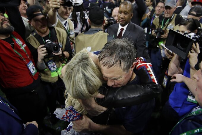New England Patriots head coach Bill Belichick hugs his girlfriend Linda Holliday, after the NFL Super Bowl 53 football game against the Los Angeles Rams, Sunday, Feb. 3, 2019, in Atlanta. The Patriots won 13-3. (AP Photo/Matt Rourke)