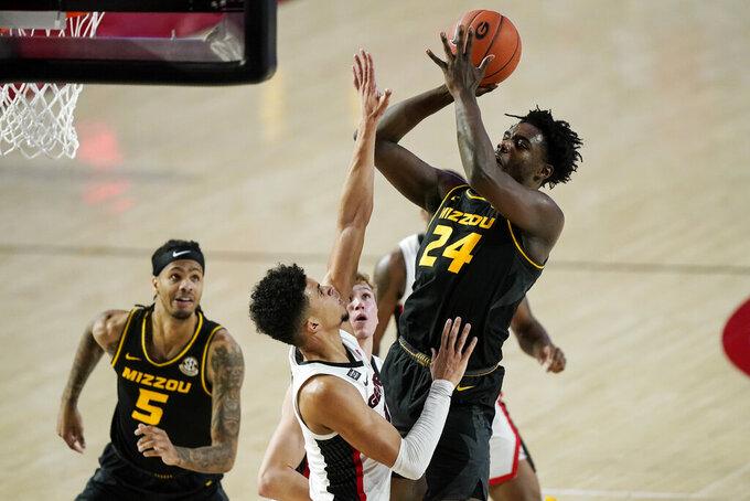 Missouri forward Kobe Brown (24) shoots against Georgia forward Toumani Camara during the first half of an NCAA college basketball game Tuesday, Feb. 16, 2021, in Athens, Ga. (AP Photo/Brynn Anderson)