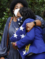 HFM*Annette Watkins, her face covered by a mask adorned with stars, holds a folded U.S. flag as she hugs a woman following the funeral of her son, Army veteran Damian Daniels, at Alabama National Cemetery in Montevallo, Ala., on Friday, Sept. 11, 2020. Daniels, an Alabama native who served in Afghanistan, was fatally shot by a sheriff's deputy at his home in San Antonio, Texas, last month. Relatives and authorities say he was troubled mentally. (AP Photo/Jay Reeves)