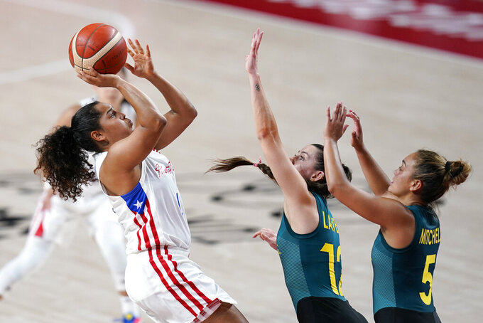 Puerto Rico's Jennifer O'Neill shoots over Australia's Tess Lavey (12) and Leilani Mitchell (5) during a women's basketball preliminary round game at the 2020 Summer Olympics, Monday, Aug. 2, 2021, in Saitama, Japan. (AP Photo/Charlie Neibergall)