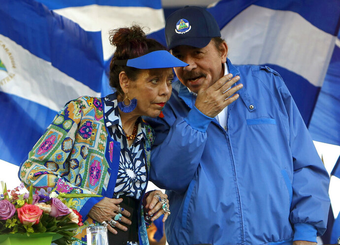 FILE - In this Sept. 5, 2018 file photo, Nicaragua's President Daniel Ortega and his wife and Vice President Rosario Murillo, lead a rally in Managua, Nicaragua. Ortega said Thursday, Feb. 21, 2019, that he will restart talks with his opponents, more than six months after breaking off the last dialogue and unleashing a round of arrests. (AP Photo/Alfredo Zuniga, File)