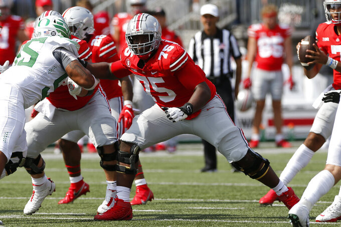 """FILE - In this Sept. 11, 2021, file photo, Ohio State offensive lineman Thayer Munford (75) plays against Oregon during an NCAA college football game in Columbus, Ohio. Munford wanted to give himself his best chance to make it to the NFL. So a star who already had been invited to the Senior Bowl decided to return and become a """"Super Senior."""" (AP Photo/Jay LaPrete, File)"""