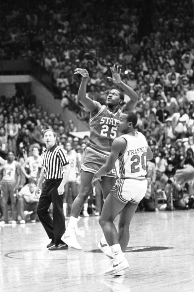 FILE - In this April 4, 1983, file photo, North Carolina State's Dereck Whittenburg (25) takes the shot which was to be dunked a spilt second later by teammate Lorenzo Charles to beat top-ranked Houston 54-52 in the NCAA college basketball championship game, in Albuquerque, N.M. The airball-turned-buzzer-beating dunk stunned top-ranked Houston. (AP Photo/File)