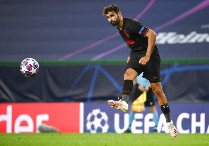 Atletico Madrid's Diego Costa kicks the ball during the Champions League quarterfinal match between RB Leipzig and Atletico Madrid at the Jose Alvalade stadium in Lisbon, Portugal, Thursday, Aug. 13, 2020. (Lluis Gene/Pool Photo via AP)