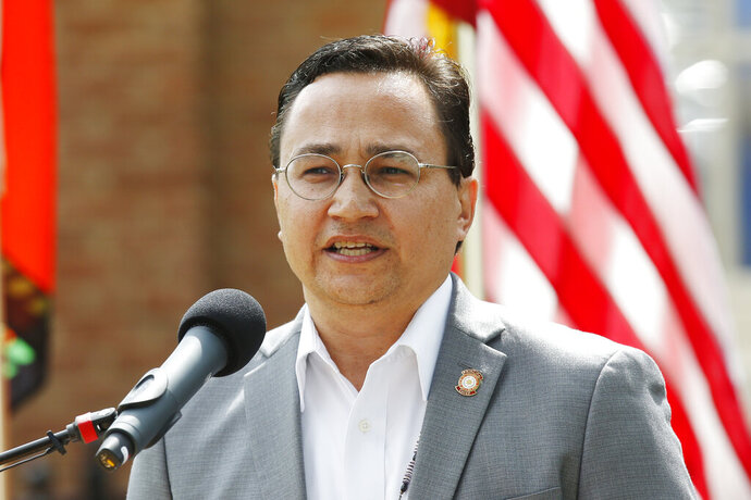 FILE - In this Aug. 22, 2019 file photo, Cherokee Nation Principal Chief Chuck Hoskin Jr., speaks during a news conference in Tahlequah, Okla. The Cherokee Nation is creating a work group to study the burgeoning hemp and cannabis industries in Oklahoma. It hopes to have a report by the end of May 2020.  (AP Photo/Sue Ogrocki, File)