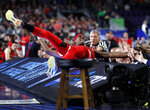 Texas Tech forward Tariq Owens lands on the scorers table while trying to save a ball from going out of bounds during the first half against Michigan State in the semifinals of the Final Four NCAA college basketball tournament, Saturday, April 6, 2019, in Minneapolis. (AP Photo/Jeff Roberson)