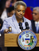 Mayor of Chicago Lori Lightfoot bangs the gavel after being sworn in at her inauguration ceremony Monday, May 20, 2019, in Chicago. (AP Photo/Jim Young)