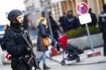 A police officer secures the area around the Hotel 'Bayerischer Hof' at the first day of the International Security Conference in Munich, Germany, Friday, Feb. 15, 2019. (AP Photo/Matthias Schrader)