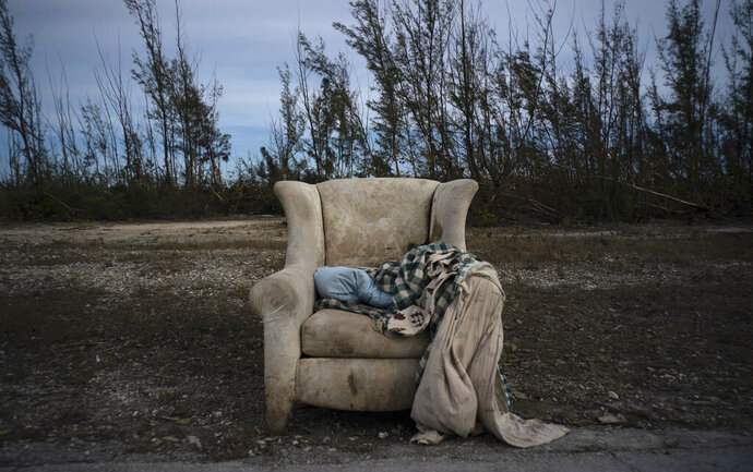 The lounger in which Virginia Mosvold was rescued from her home in Ol' Freetown Farm, flooded by the waters of Hurricane Dorian, lays abandoned on the side of the road on the outskirts of Freeport, Bahamas, Wednesday, Sept. 4, 2019. The 84-year-old Mosvold was taken to a hospital in Freeport. Rescue crews in the Bahamas fanned out across a blasted landscape of smashed and flooded homes trying to reach drenched and stunned victims of Hurricane Dorian and take the full measure of the disaster. (AP Photo/Ramon Espinosa)