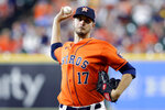 Houston Astros starting pitcher Jake Odorizzi throws against the Texas Rangers during the first inning of a baseball game Friday, July 23, 2021, in Houston. (AP Photo/Michael Wyke)