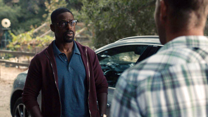 """This image released by NBC shows Sterling K. Brown in a scene from """"This Is Us."""" Season five debuts Tuesday and will address the pandemic and Black Lives Matter movement. (NBC via AP)"""