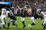 Las Vegas Raiders quarterback Derek Carr (4) throws against the Baltimore Ravens during the first half of an NFL football game, Monday, Sept. 13, 2021, in Las Vegas. (AP Photo/Rick Scuteri)