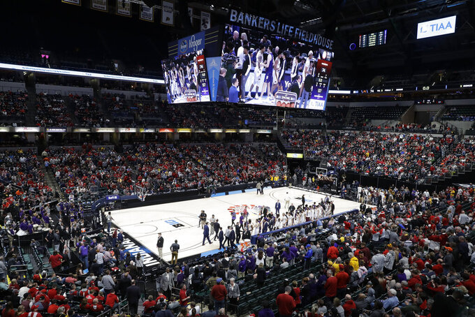 Players from Minnesota and Northwestern shake hands after an NCAA college basketball game at the Big Ten Conference tournament, Wednesday, March 11, 2020, in Indianapolis. Minnesota won 74-57. (AP Photo/Darron Cummings)